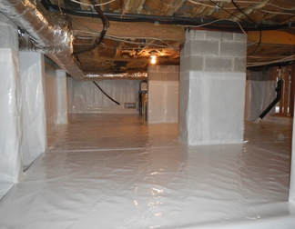 Basement crawlspace covered with thick moisture barrier with no visible insulation.
