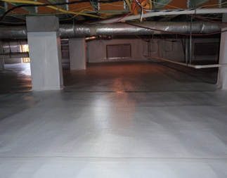 Dark encapsulated crawlspace with no standing water and visible plumbing in ceiling